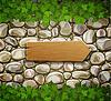 Steinmauer mit Holzpfeil und Blätter