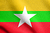 Flag of Myanmar waving in wind with fabric texture | Stock Illustration