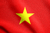 Flag of Vietnam waving in wind with fabric texture | Stock Illustration