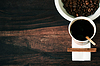 Disposable cup of coffee and coffee beans  | Stock Foto