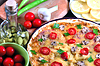 Pizza with mushrooms and ingredients closeup | Stock Foto