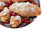 Croissants and ripe cherries | Stock Foto