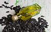Flasche Kernöl und Sonnenblumen | Stock Foto