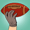 Ball des American Football in der Hand