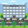 Polizeigebäude und zwei Polizeiwagen auf der Straße