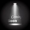 Vektor Cliparts: Kommt bald Text durch Scheinwerfer beleuchtet schwarz