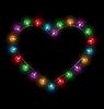 Mehrfarbige glasigen Lichter wie Herz-Rahmen auf schwarzem