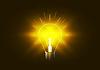 Vektor Cliparts: Helle Beleuchtung Glühbirne mit goldenem Licht in der Dunkelheit,