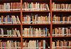 Books on a shelf in library. | 免版税照片